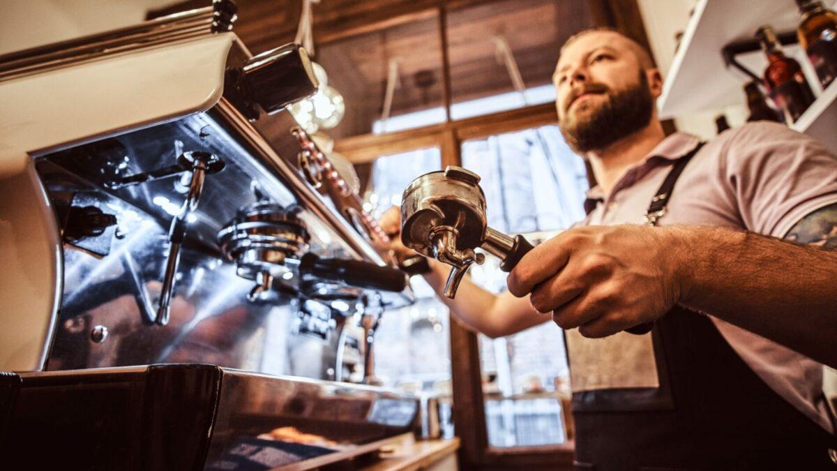 Barista making coffee at a Narragansett coffee shop