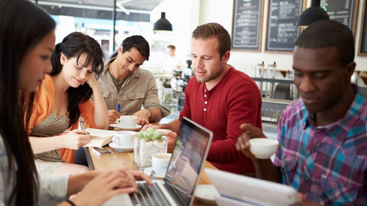 Friends enjoying coffee at a Narragansett breakfast restaurant