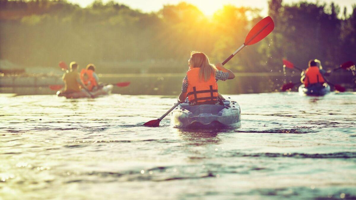 A group kayaking at sunset in Narragansett